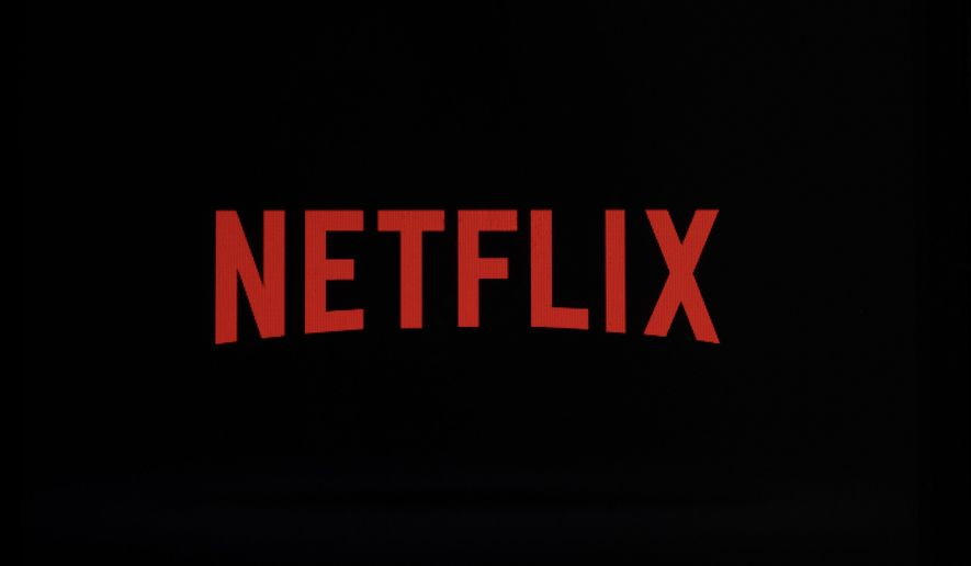 FILE- This July 17, 2017, file photo shows a Netflix logo on an iPhone in Philadelphia. Netflix, Inc. reports earnings Monday, July 16, 2018. (AP Photo/Matt Rourke, File)