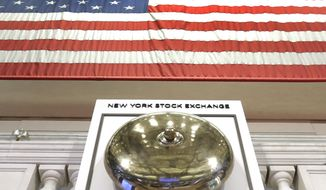 FILE- In this May 17, 2018, file photo, an American flag hangs above the bell podium on the floor of the New York Stock Exchange. The U.S. stock market opens at 9:30 a.m. EDT on Monday, July 16. (AP Photo/Richard Drew, File)