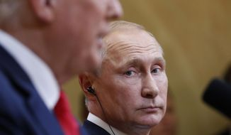 Russian President Vladimir Putin listens to U.S. President Donald Trump during a press conference after the meeting of U.S. President Donald Trump and Russian President Vladimir Putin at the Presidential Palace in Helsinki, Finland, Monday, July 16, 2018. (AP Photo/Pablo Martinez Monsivais)