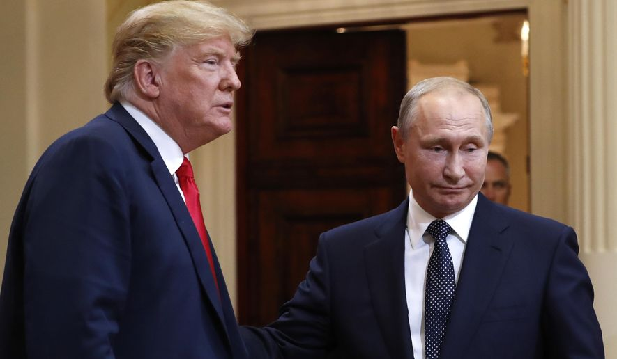 U.S. President Donald Trump, left, and Russian President Vladimir Putin leave a press conference after their meeting at the Presidential Palace in Helsinki, Finland, Monday, July 16, 2018. (AP Photo/Pablo Martinez Monsivais) **FILE**