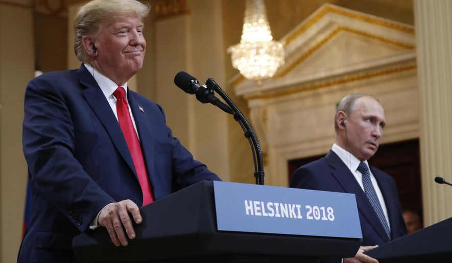 U.S. President Donald Trump, left, smiles beside Russian President Vladimir Putin during a press conference after their meeting at the Presidential Palace in Helsinki, Finland, Monday, July 16, 2018. (AP Photo/Pablo Martinez Monsivais)