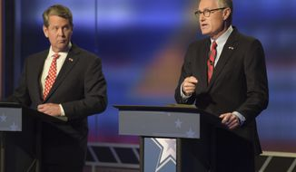 """Lt. Gov. Casey Cagle, right, responds to Secretary of State Brian Kemp's remarks about his office's role in the investigations of sexual misconduct complaints, which took place at two Massage Envy clinics, during the second and final televised debate at a Channel 2 Action News studio on Sunday, July 15 in Atlanta. Cagle says that Kemp is diverting accountability for the complaints when """"it is (Kemp's) responsibility."""" The runoff to decide the Republican candidate for governor will be held July 24. (Jenna Eason/Atlanta Journal-Constitution via AP)"""