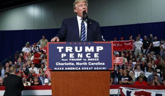 FILE - In a Friday, Oct. 14, 2016 file photo, Republican presidential candidate Donald Trump speaks during a campaign rally, in Charlotte, N.C. Charlotte is a front-runner to host the 2020 Republican Convention where President Donald Trump seeks an anointing to run for a second term. (AP Photo/ Evan Vucci, File)