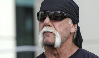 FILE - In this Oct. 15, 2012, file photo, reality TV star and former pro wrestler Hulk Hogan, whose real name is Terry Bollea, looks on as his attorney speaks in Tampa, Fla. World Wrestling Entertainment Inc. has reinstated Hogan to its Hall of Fame, three years after he was found to have used racial slurs in a conversation caught on a sex tape. (AP Photo/Chris O'Meara, File)