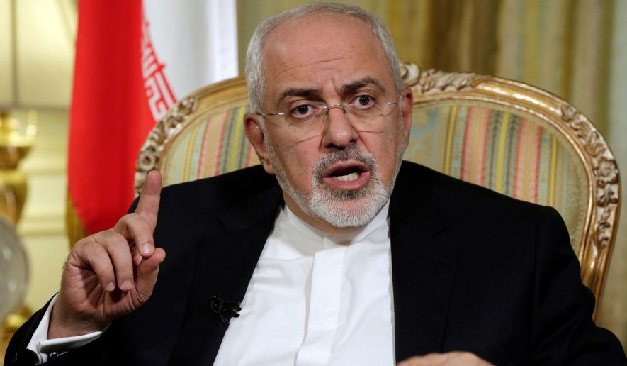 FILE - In this April 24, 2018 file photo, Iran's Foreign Minister Mohammad Javad Zarif is interviewed by The Associated Press, in New York. Iran's Foreign Ministry said Monday, July 16, 2018, that if President Donald Trump wants to negotiate after pulling the United States out of the international agreement meant to prevent Tehran from developing a nuclear weapon, he'll have to make the call. (AP Photo/Richard Drew, File)