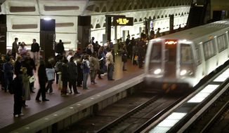 Metro's largest union has overwhelmingly authorized a potential transit system strike, just as thousands of tourists arrive in the nation's capital for the July 17, 2018 Major League Baseball All-Star Game. Union leaders said they would wait on Monday's expected response from Metro's management after Sunday's vote authorizing a strike.  (AP Photo/Lawrence Jackson, File)