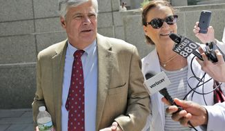 "Dean Skelos leaves federal court with his wife Gail Skelos in New York, Tuesday, July 10, 2018. The former New York state Senate leader and his son got business executives to arrange no-show jobs for the son in a brazen ""family shakedown"" that corrupted the senator's office, a federal prosecutor said Tuesday at the retrial of the pair on bribery and extortion charges. (AP Photo/Seth Wenig)"