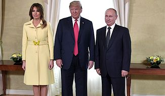 First Lady Melania Trump, President Trump and Russian President Vladimir Putin, pose for a photograph in Helsinki, Finland, just prior to the much awaited summit between the two leaders on Monday. (Alexei Nikolsky, Sputnik, Kremlin Pool Photo via AP)