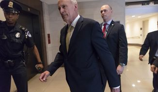 """FIEL - In this May 24, 2018, file photo, Director of National Intelligence Dan Coats arrives as House and Senate lawmakers from both parties gather for a classified briefing in a secure room about the federal investigation into President Donald Trump's 2016 campaign, on Capitol Hill in Washington. Coats says assessments of Russian meddling in the 2016 election have been """"clear"""" and describes the Kremlin's efforts to undermine the United States' democracy as """"ongoing"""" and """"pervasive."""" The statement from Coats, followed comments earlier July 16, from President Donald Trump at a news conference with Russian leader Vladimir Putin in Helsinki where Trump cast doubt on the credibility U.S. intelligence assessments.(AP Photo/J. Scott Applewhite, File)"""