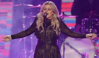"FILE - In this June 6, 2018, file photo, Kelly Clarkson performs ""American Woman"" at the CMT Music Awards at the Bridgestone Arena in Nashville, Tenn. Clarkson will headline opening night at U.S. Open. The U.S. Tennis Association announced Monday, July 16, 2018, the Grammy Award winner will perform at Arthur Ashe Stadium on Aug. 27. (AP Photo/Mark Humphrey, File)"