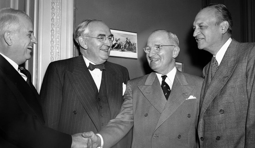 Sen. Kenneth Wherry (R-Neb.), Sen. Arthur Vandenberg (R-Mich.), President Truman and Sen. Scott Lucas (D-Ill.), left to right as they greeted the President at a luncheon marking his four years in office on April 12, 1949. (AP Photo) (Associated Press)