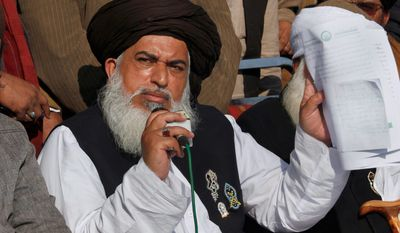 Head of the radical religious party, Tehreek-i-Labaik Ya Rasool Allah, Khadim Hussain Rizvi speaks during a press conference regarding their talks with government to end the sit-in protest in Islamabad, Pakistan, Monday, Nov. 27, 2017. Pakistani Islamists announced they were disbanding their sit-in near Islamabad after the country's law minister resigned, caving in to the protesters who have been demanding his ouster in a three-week-long rally. (AP Photo/Anjum Naveed)