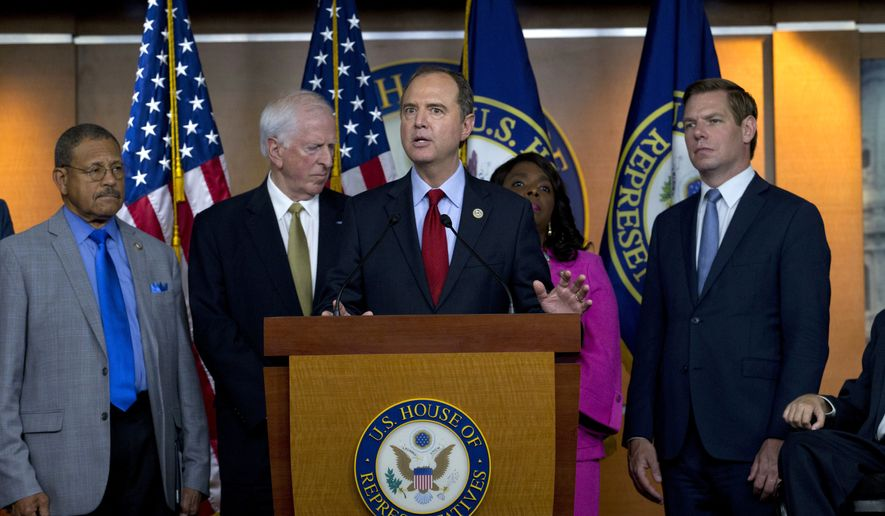 Rep. Adam Schiff, D-Calif., ranking member of the House Intelligence Committee, accompanied by other congress members speaks during a news conference on President Donald Trump's meeting with Russian President Vladimir Putin in Helsinki at Capitol Hill in Washington on Tuesday, July 17, 2018. (AP Photo/Jose Luis Magana)