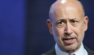 In this Sept. 24, 2014, file photo, Lloyd Blankfein, chairman and CEO of Goldman Sachs, speaks during a panel discussion at the Clinton Global Initiative, in New York. Goldman Sachs announced Tuesday, July 17, 2018, that Blankfein will retire as CEO and chairman on Sept. 30, and be replaced by Chief Operating Officer David Solomon. (AP Photo/Mark Lennihan, File)