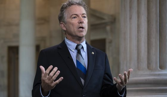 During a TV news interview, Sen. Rand Paul, R-Ky., defends President Donald Trump and his Helsinki news conference with Russian President Vladimir Putin where Trump appeared to cast doubt on U.S. intelligence findings that Russia interfered in the 2016 election, on Capitol Hill in Washington, Tuesday, July 17, 2018.  (AP Photo/J. Scott Applewhite)