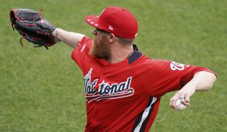 Washington Nationals pitcher Sean Doolittle warms up ahead of the 89th MLB baseball All-Star Game, Tuesday, July 17, 2018, at Nationals Park, in Washington. (AP Photo/Carolyn Kaster)