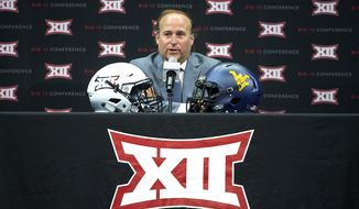 West Virginia head coach Dana Holgorsen speaks during the NCAA college football Big 12 media days in Frisco, Texas, Tuesday, July 17, 2018. (AP Photo/Cooper Neill)