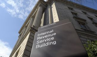 FILE - This March 22, 2013 file photo shows the exterior of the Internal Revenue Service (IRS) building in Washington.  The Trump administration is lifting requirements for some tax-exempt groups to disclose the identities of their donors to federal tax authorities, announced late Monday, July 16, 2018. The change benefits groups that spend millions of dollars on political ads, such as the U.S. Chamber of Commerce and an organization tied to the billionaire Koch brothers. (AP Photo/Susan Walsh, File)