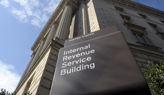 FILE - This March 22, 2013 file photo shows the exterior of the Internal Revenue Service (IRS) building in Washington.  The Trump administration is lifting requirements for some tax-exempt groups to disclose the identities of their donors to federal tax authorities, announced late Monday, July 16, 2018. The change benefits groups that spend millions of dollars on political ads, such as the U.S. Chamber of Commerce and an organization tied to the billionaire Koch brothers. (AP Photo/Susan Walsh, File) **FILE**