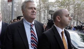 FILE - In this Dec. 11, 2015, file photo, former New York state Senate leader Dean Skelos, left, and his son Adam Skelos leave federal court, in New York. Skelos and his son have been convicted of bribery, wire fraud and extortion charges at their federal corruption trial on Tuesday, July 17, 2018. The two were accused of selling the once-powerful Republican's office by pressuring wealthy businessmen into giving Adam Skelos roughly $300,000 for no-show jobs. (AP Photo/Richard Drew, File)