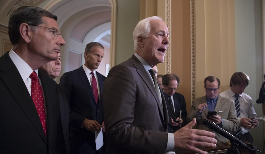 Senate Majority Whip John Cornyn, R-Texas, center, joined by, from left, Sen. John Barrasso, R-Wyo., Sen. Roy Blunt, R-Mo., and Sen. John Thune, R-S.D., tell reporters they are aiming to confirm Supreme Court nominee Brett Kavanaugh in time for the opening of the high court's term in October, during a news conference on Capitol Hill in Washington, Tuesday, July 17, 2018. (AP Photo/J. Scott Applewhite)
