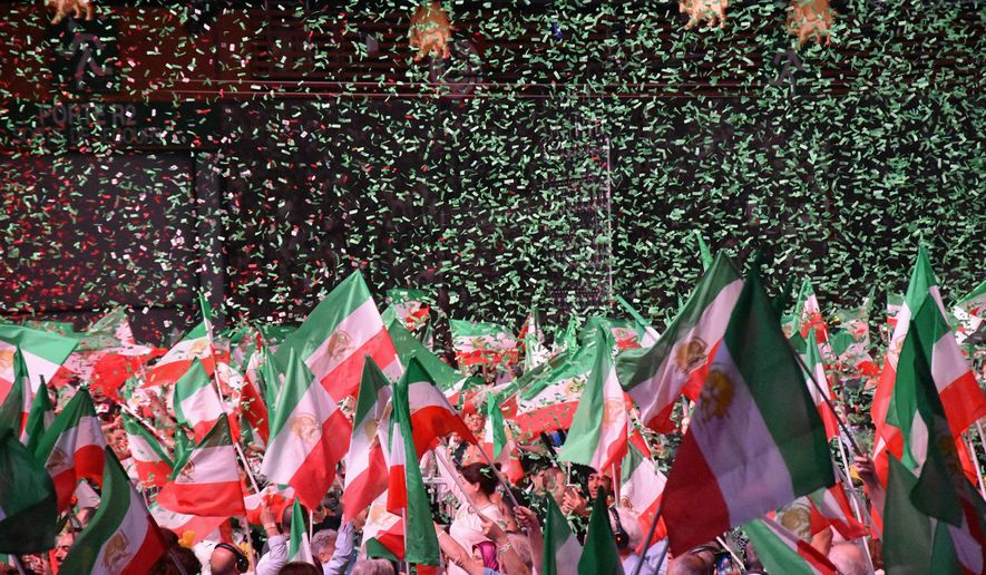 The National Council of Resistance of Iran, which has found new prominence in the Trump administration, rallied in Paris. (Sarah Wachter/Special to The Washington Times)