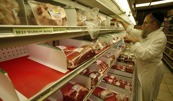 Rabbi Moishe Silverman stocks liver in a partially empty meat display at South Florida Kosher, a butcher shop in North Miami Beach, Fla., Tuesday, Nov. 25, 2008. Agriprocessors, the nation's largest kosher slaughterhouse, stopped shipping beef about three weeks ago, chicken in the last week. The shutdown has cut the kosher food world to the bone. Other processors have been swamped with orders, boosting the number of days they produce kosher meat or refusing to take new clients. (AP Photo/Wilfredo Lee)