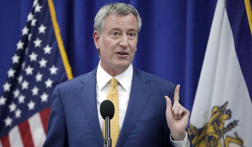 """Our message is clear: the Trump Administration's actions are illegal and morally bankrupt,"" New York City Mayor Bill de Blasio said in a release. (Associated Press)"