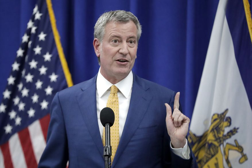 """""""Our message is clear: the Trump Administration's actions are illegal and morally bankrupt,"""" New York City Mayor Bill de Blasio said in a release. (Associated Press)"""