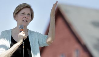 Sen. Elizabeth Warren, D-Mass., addresses an audience at Belkin Family Lookout Farm during a town hall event, Sunday, July 8, 2018, in Natick, Mass. Warren hosted the town hall and cookout following an Independence Day trip to visit U.S. troops in Iraq and Kuwait. (AP Photo/Steven Senne)
