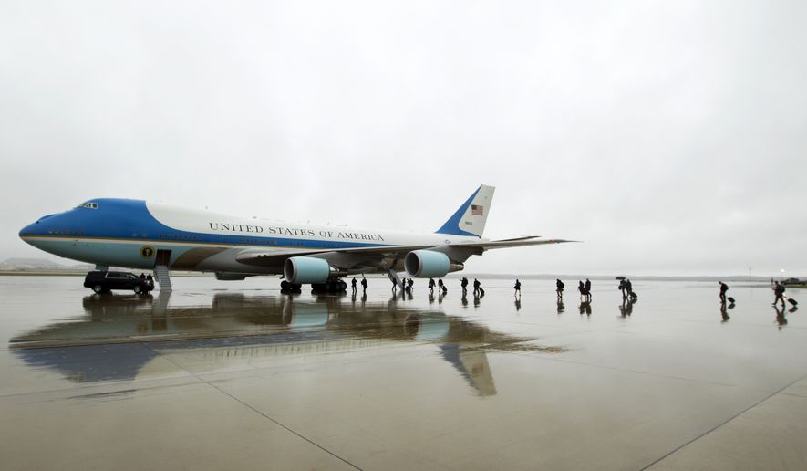 In this April 6, 2017, file photo, members of the White House press corps board Air Force One before the arrival of President Donald Trump at Andrews Air Force Base, Md. Trump says Air Force One is getting a patriotic makeover. Trump says the familiar baby blue color on current models of the presidential aircraft will give way to red-white-and-blue coloring on updated models that could be in service in time for a potential second term. (AP Photo/Jose Luis Magana, File)