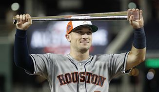 MVP Houston Astros Alex Bregman holds the trophy after the 89th MLB baseball All-Star Game, Wednesday, July 18, 2018, at Nationals Park, in Washington. The American League won 8-6. (AP Photo/Alex Brandon)