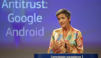 EU Commissioner Margrethe Vestager holds a press conference on a Competition Case involving Google Android at the European Commission building, in Brussels on Wednesday, July 18, 2018. he European Union's antitrust chief has fined Google a record $5 billion for abusing the market dominance of its Android mobile phone operating system. (AP Photo/Olivier Matthys)