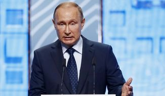 Russian President Vladimir Putin addresses Moscow Urban Forum 2018, in Moscow, Russia, Wednesday, July 18, 2018. The forum focuses on a discussion of the results of large-scale urban transformations over the last decades, the plans for building cities of the future. (Sergei Karpukhin/Pool Photo via AP)