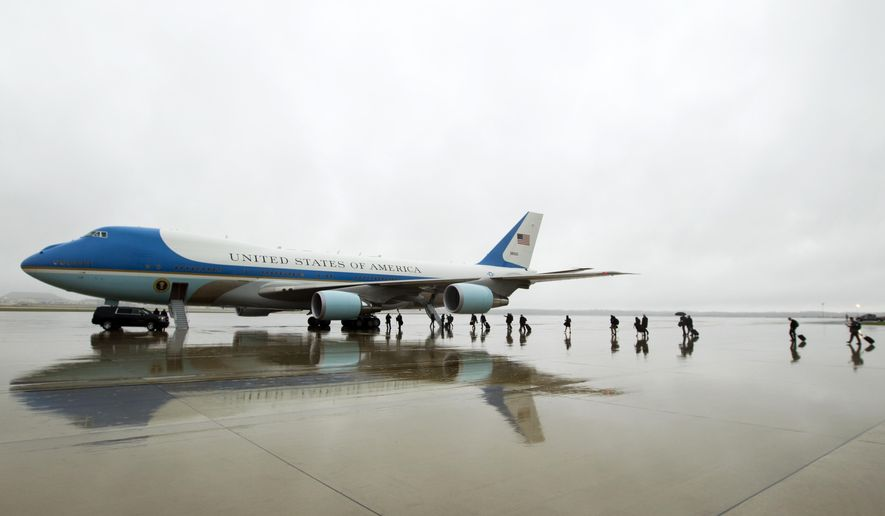 FILE - In this April 6, 2017, file photo, members of the White House press corps board Air Force One before the arrival of President Donald Trump at Andrews Air Force Base, Md.   Trump says Air Force One is getting a patriotic makeover. Trump says the familiar baby blue color on current models of the presidential aircraft will give way to red-white-and-blue coloring on updated models that could be in service in time for a potential second term. (AP Photo/Jose Luis Magana, File)