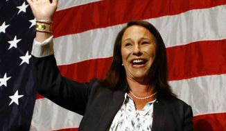 Alabama Rep. Martha Roby waves to supporters during the watch party as she wins the runoff election, Tuesday, July 17, 2018, in Montgomery, Ala. Roby won Alabama's Republican runoff on Tuesday, fighting through lingering fallout from her years-old criticism of then-candidate Donald Trump in a midterm contest that hinged on loyalty to the GOP president.. (AP Photo/Butch Dill)