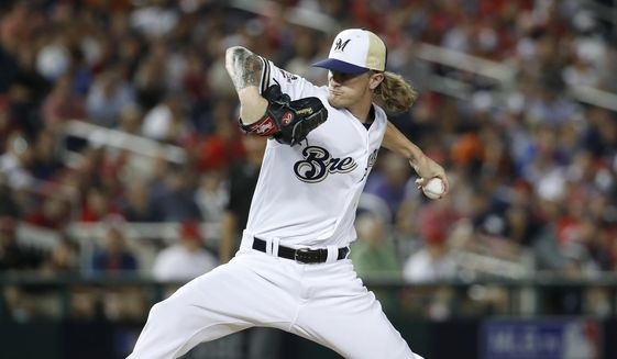 Milwaukee Brewers pitcher Josh Hader (71) throws during the eighth inning at the Major League Baseball All-star Game, Tuesday, July 17, 2018 in Washington. (AP Photo/Alex Brandon) ** FILE **