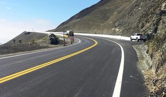 This photo provided by the California Department of Transportation (Caltrans) shows the stretch of Highway 1 that has been rebuilt and opened for traffic Wednesday morning, July 18, 2018, near Big Sur, Calif., on the California coast. The coastal road that links San Francisco and Los Angeles was blocked by a massive landslide in May, 2017 that moved millions of tons of earth, displacing 75 acres (30 hectares) of land. (Caltrans via AP)
