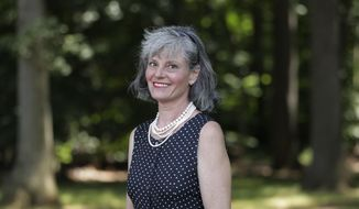 In a photo taken Thursday, July 12, 2018, Carol Hafner poses for The Associated Press in Lincroft, N.J. Hafner is a congressional candidate running in the August primary election in the U.S. House in Alaska. (AP Photo/Julio Cortez)