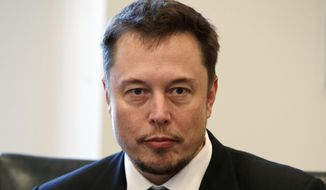In this Dec. 14, 2016, file photo, Tesla CEO Elon Musk listens as President-elect Donald Trump speaks during a meeting with technology industry leaders at Trump Tower in New York. Musk has apologized for calling a British diver involved in the Thailand cave rescue a pedophile. (AP Photo/Evan Vucci, File)