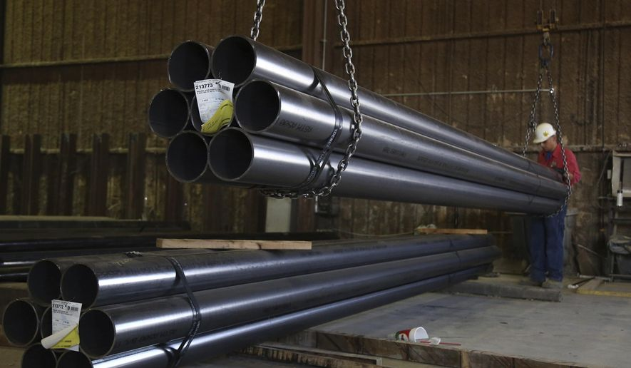 In this Friday, July 13, 2018 photo, a worker lifts steel tubing to be shipped out from Metals 2 Go at their plant in Waco, Texas. As Trump's trade war plays out on the world stage, local small businesses are feeling the pinch and looking for strategies to ride out the storm. (Rod Aydelotte/Waco Tribune-Herald via AP)
