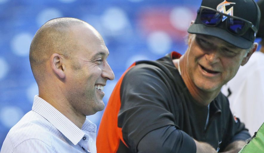 FILE - In this April 10, 2018, file photo, Miami Marlins CEO Derek Jeter, left, and manager Don Mattingly share a laugh as they watch batting practice before the start of a baseball game against the New York Mets, in Miami. By one reading of the Derek Jeter meter, not much has changed with the Miami Marlins since he took over. They have by far the worst run differential in the National League. But within the franchise, optimism is the highest it has been since unpopular owner Jeffrey Loria put the Marlins up for sale in early 2017. (AP Photo/Wilfredo Lee, File)