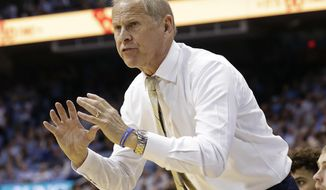 FILE - In this Nov. 29, 2017, file photo, Michigan coach John Beilein gestures during the second half of the team's NCAA college basketball game against North Carolina in Chapel Hill, N.C. Michigan coach John Beilein has agreed to a contract extension through the 2022-23 season. The 65-year-old Beilein has been at Michigan for 11 seasons and took the Wolverines to the national championship game in 2013 and 2018. (AP Photo/Gerry Broome, File)
