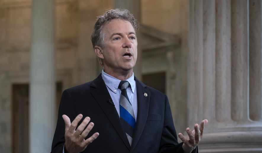 In this July 17, 2018, file photo, Sen. Rand Paul, R-Ky., speaks during a television interview as he defends President Donald Trump and his Helsinki news conference with Russian President Vladimir Putin on Capitol Hill in Washington. (AP Photo/J. Scott Applewhite)