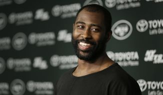 FILE - In this Aug. 11, 2015, file photo, New York Jets' Darrelle Revis speaks to the media after a Jets practice in Florham Park, N.J.  Revis, a star cornerback with the New York Jets and a Super Bowl winner with their archrivals, the Patriots, has retired. Revis announced Wednesday, July 18, 2018, on Twitter that he was ending an 11-season career that included four All-Pro selections. (AP Photo/Seth Wenig, File)