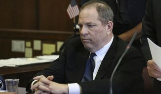 FILE - In this July 9, 2018, file photo, Harvey Weinstein attends his arraignment in court in New York. Weinstein's lawyers say Ashley Judd's allegations that he tried to hurt her career after she rejected him sexually are baseless, and they have asked a judge to dismiss her lawsuit against him. The court documents filed Wednesday, July 18, discuss Judd's comment that she would only let Weinstein touch her after she won an Academy Award in one of his films. (Jefferson Siegel/The Daily News via AP, Pool, File)