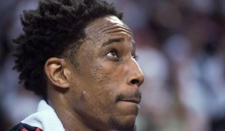 FILE - In this April 25, 2018, file photo, Toronto Raptors' DeMar DeRozan looks up at the scoreboard late in the second against the Washington Wizards in Game 5 of an NBA basketball first-round playoff series, in Toronto. Two people familiar with the situation say San Antonio and Toronto have reached an agreement in principle on a trade that will send Kawhi Leonard to the Raptors and DeMar DeRozan to the Spurs. One of the people says the Spurs also are sending Danny Green to the Raptors as part of the deal. Both people spoke to The Associated Press on condition of anonymity Wednesday, July 18, 2018, because the deal has not been finalized. (Frank Gunn/The Canadian Press via AP, File)