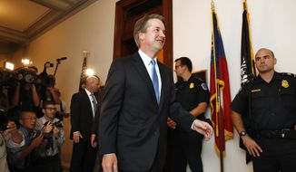 Supreme Court nominee Judge Brett Kavanaugh, center, walks to the office of Sen. Johnny Isakson, R-Ga., for a meeting Tuesday, July 17, 2018, on Capitol Hill in Washington. (AP Photo/Jacquelyn Martin)