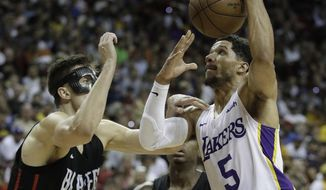 Los Angeles Lakers' Josh Hart shoots around Portland Trail Blazers' Zach Collins during the second half of an NBA summer league basketball game Tuesday, July 17, 2018, in Las Vegas. (AP Photo/John Locher)