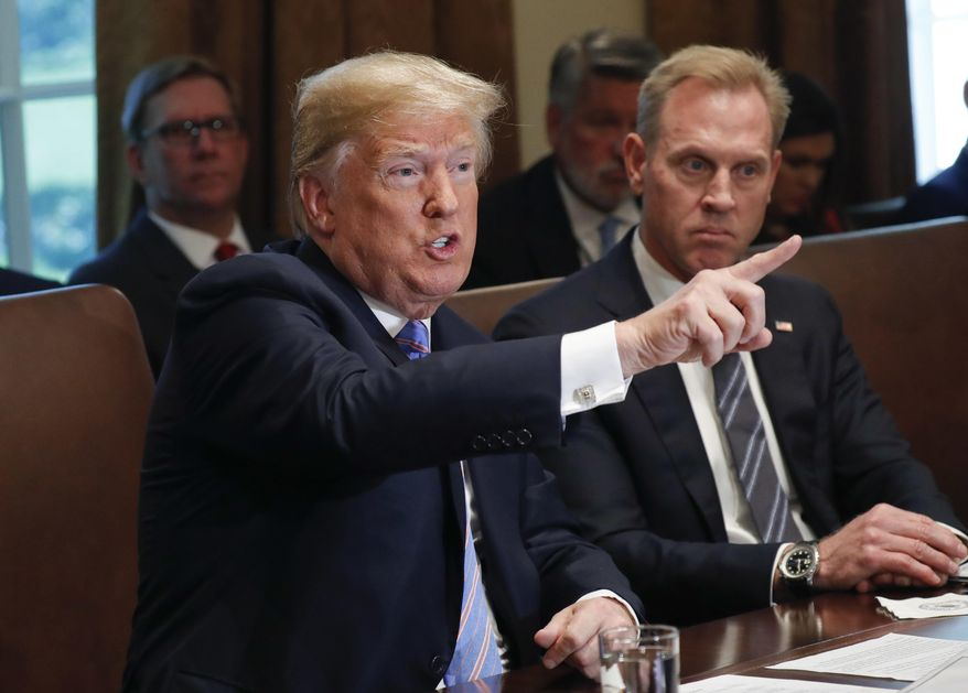 President Donald Trump gestures while speaking during his meeting with members of his cabinet in Cabinet Room of the White House in Washington, Wednesday, July 18, 2018. Looking on is Deputy Secretary of Defense Patrick Shanahan. (AP Photo/Pablo Martinez Monsivais) ** FILE **
